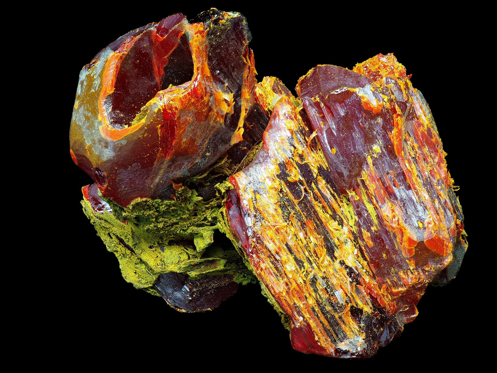 A fascinating formation of a few rich red Realgar crystals with partial green Anorpiment coating, and an as-yet-unidentified yellow/orange mineral.