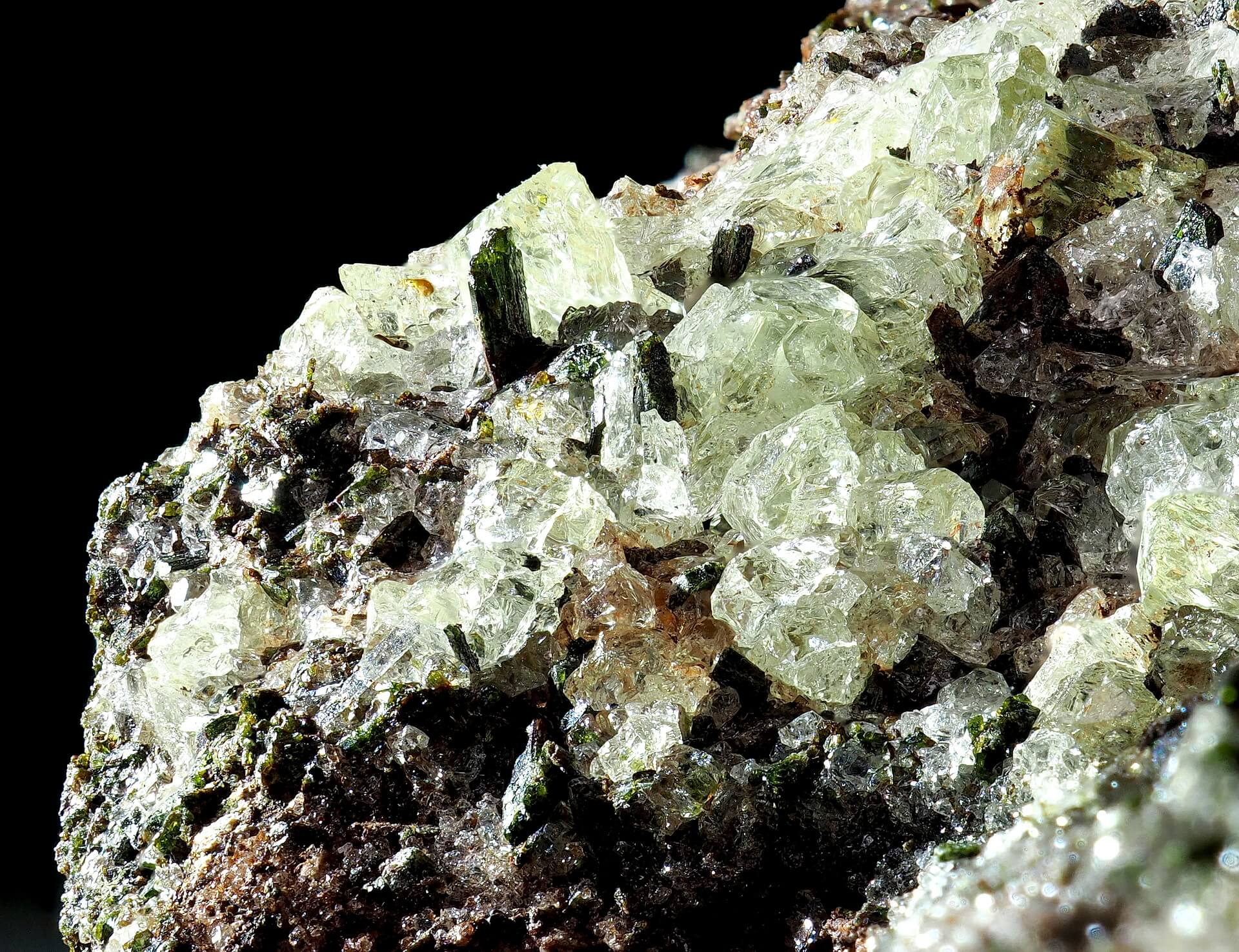Green Augite crystals surrounded by Calcite.