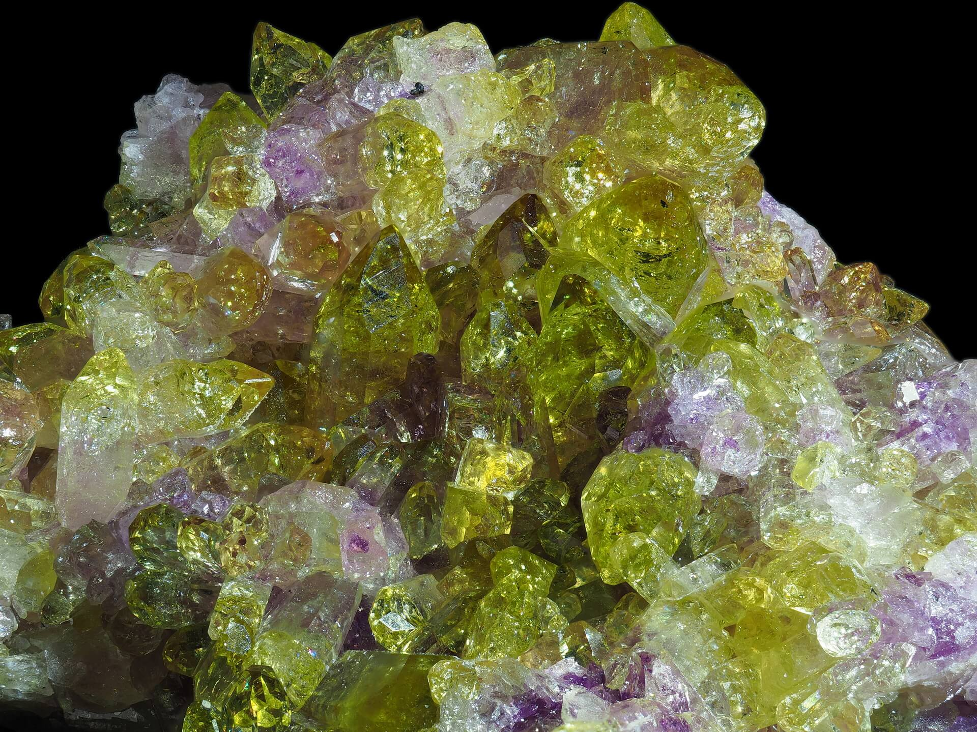 Translucent yellow Vesuvianite and its pink Manganoan variety.