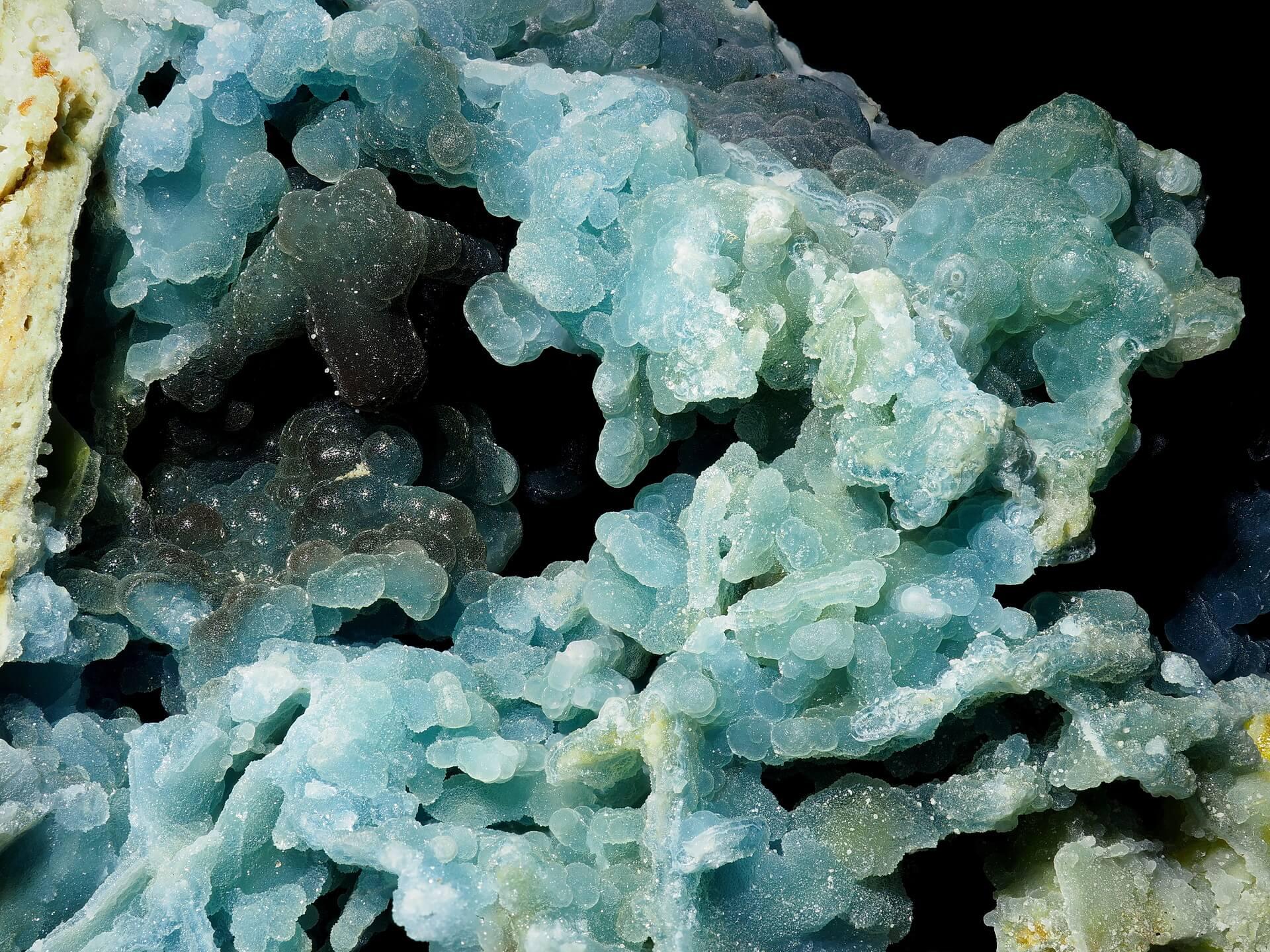 Blue Plumbogummite balls surrounding a small vug.