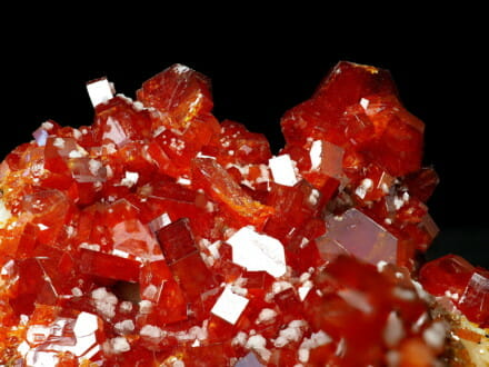 red vanadinite crystals with white baryte dots